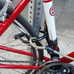 Secure your back tire to the pole within the triangle of the frame.