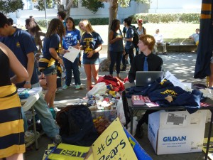 Rally Committee held a 'Get the Red Out T-Shirt Exchange' just by all the tree-chopping, accepting two canned goods and a red shirt in exchange for a blue and gold Big Game shirt.